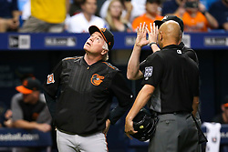 September 29, 2017 - St. Petersburg, Florida, U.S. - WILL VRAGOVIC   |   Times.Baltimore Orioles manager Buck Showalter (26) talks with the officiating crew after the single by Tampa Bay Rays right fielder Cesar Puello (30) hit the catwalk staircase in the fourth inning of the game between the Baltimore Orioles and the Tampa Bay Rays at Tropicana Field in St. Petersburg, Fla. on Friday, Sept. 29, 2017. (Credit Image: © Will Vragovic/Tampa Bay Times via ZUMA Wire)