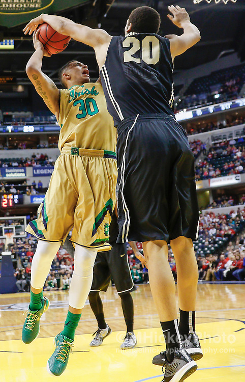 INDIANAPOLIS, IN - DECEMBER  20: Zach Auguste #30 of the Notre Dame Fighting Irish shoots the ball as A.J. Hammons #20 of the Purdue Boilermakers gets a hand on it at Bankers Life Fieldhouse on December 20, 2014 in Indianapolis, Indiana. Indiana defeated Butler 82-73. (Photo by Michael Hickey/Getty Images) *** Local Caption *** Zach Auguste; A.J. Hammons