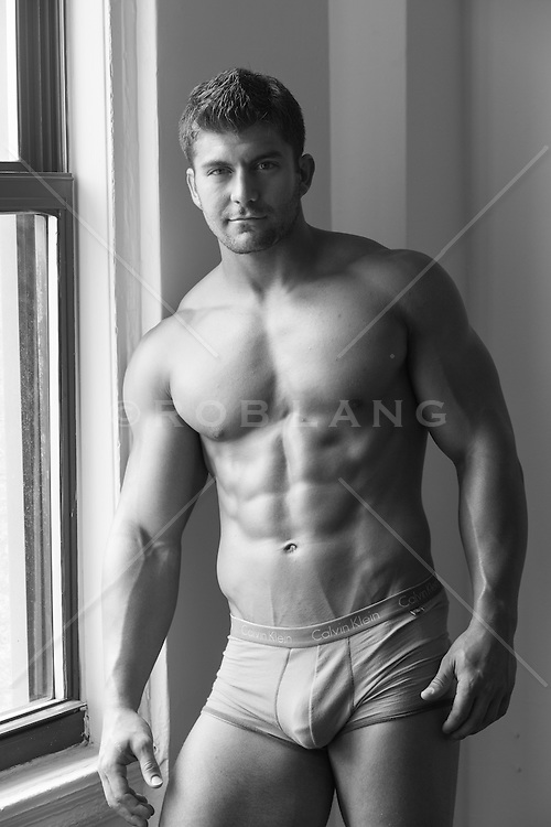 sexy man in his briefs at home
