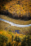Clouds uncover enough sunlight to shine a spotlight on a bend in the Carp RIver.<br /> Porcupine Mountains Wilderness