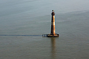 Aerial view of Morris Island Light, a coastal lighthouse built in 1976 on Morris Island, South Carolina. Erosion and rising seas has surrounded the island which now stands several hundred feet off the coastline.