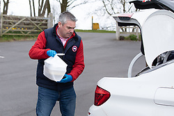 © Licensed to London News Pictures. 30/03/2020. Baddesley, North Warwickshire, UK. MP Delivery. North Warwickshire MP Craig Tracey turns delivery man to help deliver meals in his constituency. When Atherstone coffee shop owner Angie Spencer decided to make meals for people who were housebound she asked for volunteers to help deliver the meals. The local community responded along with local MP Craig Tracey. The meals will be delivered on Mondays and Fridays to start with, the first going out today (Monday 30th March) with over 100 meals being delivered. Angie has put out a request for more drivers should the need rise. Angie, a local town councillor started the idea along with business partner Stephen Reay and asked Warwickshire County Council to help with the scheme. Photo credit: Dave Warren / LNP