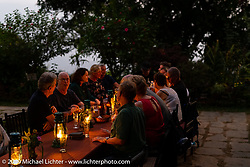 Dining outside at the farm to table Famous Farmhouse where we spent a night on Motorcycle Sherpa's Ride to the Heavens motorcycle adventure in the Himalayas of Nepal. This first day of riding took us from Kathmandu to Nuwakot. Monday, November 4, 2019. Photography ©2019 Michael Lichter.