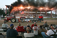 Jeff McConnell, from Volant, PA, rides his International 1066 tractor in the 2011 Stoneboro Fair tractor pull.