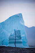 "An iceberg with a vertical line of dense blue ice running through from top to bottom, at the mouth of Kangderluqussuaq Fjord, East Greenland, 2009 This mage can be licensed via Millennium Images. Contact me for more details, or email mail@milim.com For giclée prints, contact me, or click ""add to cart"" to some standard print options."