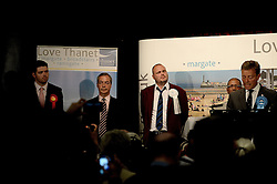 UKIP leader Nigel Farage tries to contain his emotions during Conservative candidate Craig MacKinlay's victory speech after the announcement of the 2015 South Thanet election results in the Winter Gardens, Margate. Photo credit: Mary Turner