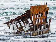 Pacific waves crash through a shipwreck skeleton. In 1906, the crew of the sailing ship Peter Iredale took refuge at Fort Stevens, after she ran aground on Clatsop Spit. The wreck is visible today, within Fort Stevens State Park, along the Oregon Coast, USA. Active from 1863–1947, Fort Stevens was an American military installation that guarded the mouth of the Columbia River in the state of Oregon. Built near the end of the American Civil War, it was named for a slain Civil War general and former Washington Territory governor, Isaac I. Stevens.