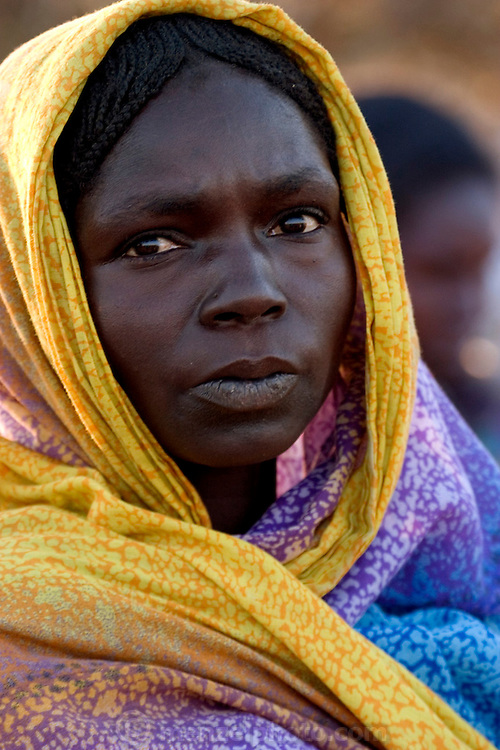 (MODEL RELEASED IMAGE). Sudanese Refugee D'jimia Ishakh Souleymane at the Breidjing Refugee Camp in eastern Chad. Hungry Planet: What the World Eats (p. 65).
