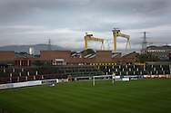 A view across the ground towards the away end with the distinctive Harland and Wolfe ship cranes in the background at The Oval, Belfast, pictured before Glentoran hosted city-rivals Cliftonville in an NIFL Premiership match. Glentoran, formed in 1892, have been based at The Oval since their formation and are historically one of Northern Ireland's 'big two' football clubs. They had an unprecendentally bad start to the 2016-17 league campaign, but came from behind to win this fixture 2-1, watched by a crowd of 1872.
