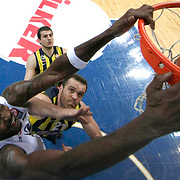 Fenerbahce Ulker's Oguz Savas (2ndL) and Anadolu Efes's Stephane Lasme (L) during their Turkish Airlines Euroleague Basketball Top 16 Round 14 match Fenerbahce Ulker between Anadolu Efes at the Ulker Sports Arena in Istanbul, Turkey, Thursday 09 April, 2015. Photo by Aykut AKICI/TURKPIX