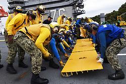 April 28, 2019 - Yokosuka, Japan - Apr 28, 2019 - Yokosuka, Japan - Sailors place aircraft barricade ramps on the flight deck of the aircraft carrier USS Ronald Reagan in Yokosuka, Japan, April 28, 2019. (Credit Image: ? U.S./ZUMA Wire/ZUMAPRESS.com) (Credit Image: ? U.S./ZUMA Wire/ZUMAPRESS.com)