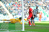 Plymouth Argyle's Jamille Matt watches York City Goalkeeper Scott Flinders save his shot during the Sky Bet League 2 match between Plymouth Argyle and York City at Home Park, Plymouth, England on 28 March 2016. Photo by Graham Hunt.
