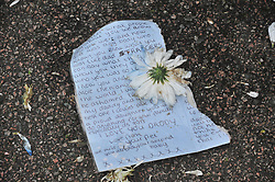 © Licensed to London News Pictures.11/04/2018<br /> HITHER GREEN, UK.<br /> A SHRINE letter to Henry Vincent from his Daughter is now wet and ripped on the pavement this evening.<br />  Hither Green Burglary Murder. South Park Crescent,Hither Green.<br />  Home of 78 year old Richard Osborn-Brooks who stabbed a burglar to death in his home.<br /> Photo credit: Grant Falvey/LNP