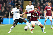 Swansea City midfielder Nathan Dyer (12) battles for possession  with Aston Villa midfielder Callum O'Hare (38) during the The FA Cup 3rd round match between Aston Villa and Swansea City at Villa Park, Birmingham, England on 5 January 2019.