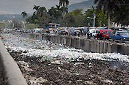 Waterway in Port-au-Prince, Haiti full of garbage. Haiti has little sanitation which is a factor in the spreading of the cholera epidemic.  Creeks and waterways full of unsanitized water helps fuel the choleral epedmic that started in Northen haiti in October 2010