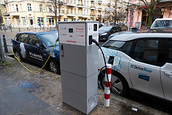 Two electric cars , part of car sharing schemes  charging on street in Prenzlauer Berg, Berlin, Germany