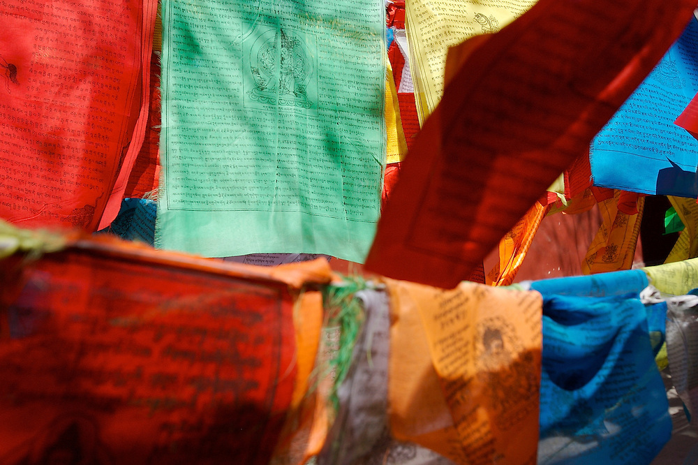 Layers of prayer flags hang along the back wall of the Miaoying Temple, also called the White Stupa Temple in Beijing,China.
