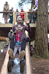 © Licensed to London News Pictures. 30/01/2016. Slough, UK. Russel Brand with Daisy Adams, 12, at the formal opening of a wooden treehouse in memory of murder victim Alice Adams in Black Park, Wexham on Saturday 30th January. The 20-year-old was stabbed to death in August 2011 with her friend and co-worker Tibor Vass, at a staff flat behind the Radisson Edwardian Hotel near Heathrow Airport. The murderer was Attila Ban, aged 32,  who also worked at the hotel as a receptionist. After the death of Alice, her family created a charity called, Alice Adams Foundation, to raise money to build the treehouse. Photo credit should read: Emma Sheppard/LNP