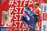 Blackpool Midfielder Kenneth Dougall (12) and Blackpool Forward Keshi Anderson (8) celebrate winning promotion during the EFL Sky Bet League 1 Play-Off Final match between Blackpool and Lincoln City at Wembley Stadium, London, England on 30 May 2021.