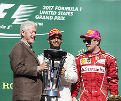 October 22, 2017 - Austin, Texas, U.S - Former 42nd President of the United States '' BILL CLINTON'' presenting the trophy to the winner #44 LEWIS HAMILTON driver for Mercedes AMG Petronas F1 Team. (Credit Image: © Hoss Mcbain via ZUMA Wire)