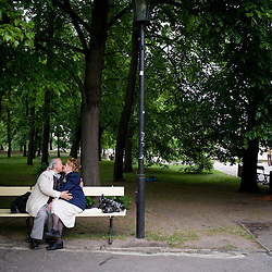 Warsaw, Poland - May, 2009 - Lovers kiss inside SaxonGardens, built in the 18th century as the city's first public park. It was modelled on Versailles and is filled with (reproduction) Baroque statues. .Photo © Susana Raab 2009