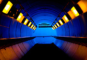 The glow of mixed light sources lights up the pedestrian tunnel under the railroad tracks a the Winfield Train Station.  I set my camera to its tungsten color balance setting to compensate for the very yellow lights inside the tunnel and make all the daylight that is spilling into the tunnel appear very blue.  The combination of the multiple types of light sources and the round tunnel gave this images in my opinion a very sci-fi look.