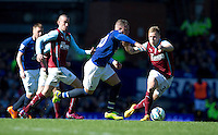 Everton's Ross Barkley tries to get away from Burnley's Scott Arfield<br /> <br /> Photographer Stephen White/CameraSport<br /> <br /> Football - Barclays Premiership - Everton v Burnley - Saturday 18th April 2015 - Goodison Park - Everton<br /> <br /> © CameraSport - 43 Linden Ave. Countesthorpe. Leicester. England. LE8 5PG - Tel: +44 (0) 116 277 4147 - admin@camerasport.com - www.camerasport.com