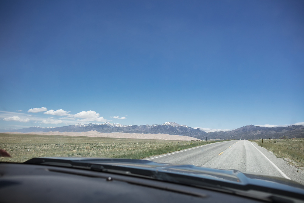 The view from the passanger seat of the sand dunes from the drive to the Great Sand Dune National Park