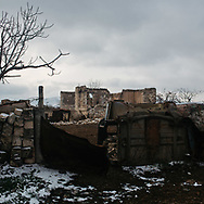Asia, Azerbaijan, Nagorno-Karabakh, Jebrail<br /> <br /> Destroyed homes and signs of life in a village in Agdam province, an area retaken by Azerbaijani forces, from Armenian control, in November 2020.