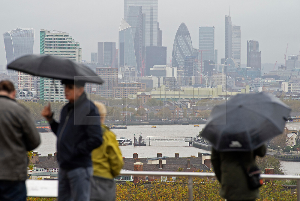 ©Licensed to London News Pictures 29/10/2020  <br /> Greenwich, UK. A wet view of London. People out and about in Greenwich Park, London. October is set to be the wettest month in years as an Atlantic storm brings wet and windy weather to parts of the UK today. Photo credit:Grant Falvey/LNP