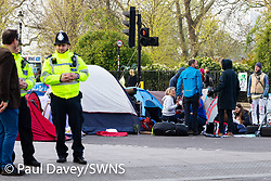 Police appear to be engaging with activists and the public as hundreds of environmental protesters from Extinction Rebellion occupy Marble Arch, camping in the square and even on the streets, blocking access to traffic on Park Lane and Oxford Street in London's usually traffic-heavy west end. . London, April 16 2019.