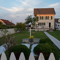 August 4, 2017 - Tangier Island, VA - Front yard cemeteries are a common site on Tangier Island where connection to community and ancestry are very much on display.<br /> Photo by Susana Raab/Institute