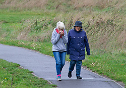©Licensed to London News Pictures 08/10/2020  <br /> Sidcup, UK. Walkers enjoying a brisk walk. Cold and wet autumn weather this morning at Footscray Meadows in Sidcup, South East London. Photo credit:Grant Falvey/LNP