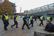 Police conduct a foot patrol around Kings Cross station after an anti-lockdown protest was announced to oppose coronavirus restrictions in London, on Saturday, Nov 28, 2020. Some of the members of the public were challenged after seen not wearing face masks by the police, some of them were detained and arrested. (Photo/ Vudi Xhymshiti)