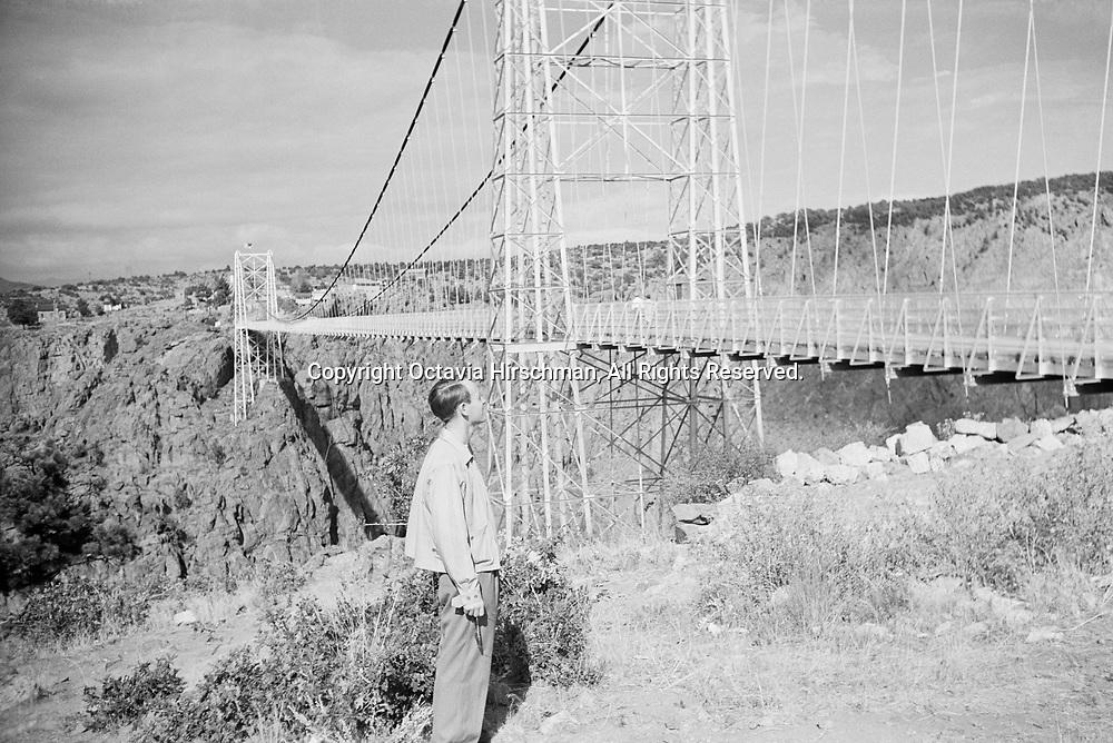 Frederick L. Hirschman overlooking the Royal Gorge Bridge spanning the Arkansas River, Cañon City, Colorado.