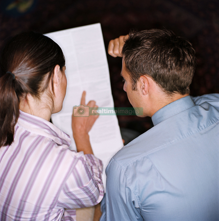 Dec. 14, 2012 - Couple planning their finances (Credit Image: © Image Source/ZUMAPRESS.com)