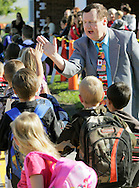 Goshen Superintendent Daniel T. Connor greets students in front of Scotchtown Elementary School on the first day of classes, Wednesday, Sept. 2, 2009. This is Connor's first year as superintendent in Goshen.