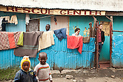 Nairobi, June 2010 -  The street front of the Agape Hope Center.  Lusweti a  director of another children's home and two directors from flying kites oasis project wait to meet the centers directors while local kids enjoy the camera. T