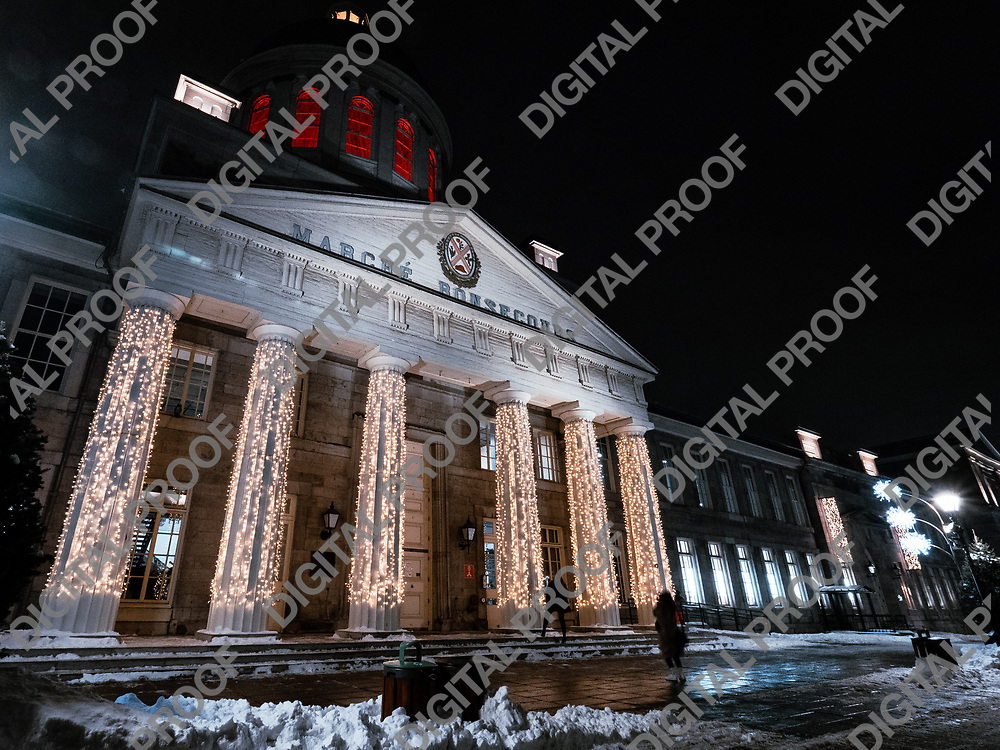 Marche Bonsecours in Old Montreal at night illuminated with christmas lights with some snow viewed from below