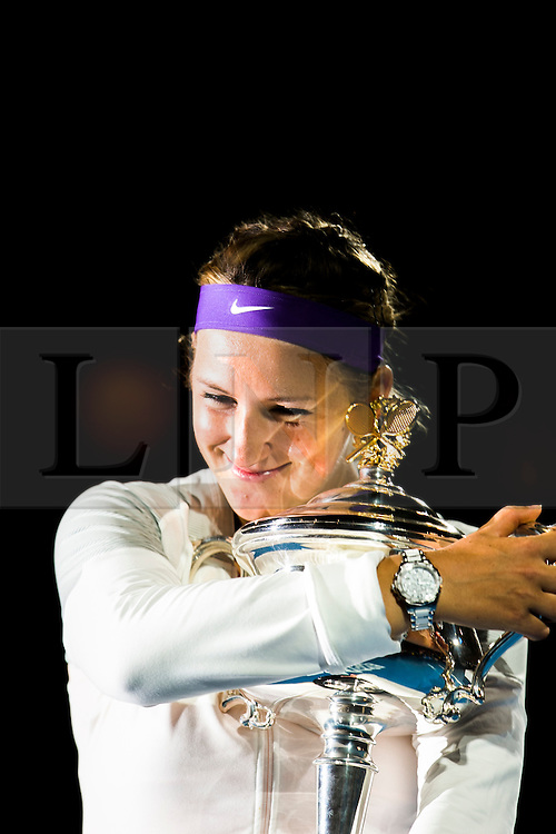 © Licensed to London News Pictures. 26/01/2013. Melbourne Park, Australia. Victoria Azarenka hugs her winner trophy while closing her eyes during the Womens Final between Victoria Azarenka and Li Na of the Australian Open. Photo credit : Asanka Brendon Ratnayake/LNP