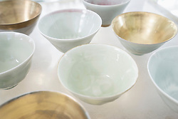 Close-up of porcelain bowls on glass table, Bavaria, Germany