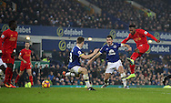 Daniel Sturridge of Liverpool has a shot which hits the post and is turned in by Sadio Mané of Liverpool for the winning goal during the English Premier League match at Goodison Park, Liverpool. Picture date: December 19th, 2016. Photo credit should read: Lynne Cameron/Sportimage