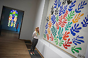 """The Sheaf and Acanthus and Nuit de Noel - stained glass. Tate Modern's new exhibition, Henri Matisse: The Cut-Outs, is devoted to the artist's paper cut-outs made between 1943 and 1954. It brings together around 120 works, many seen together for the first time, in a """"groundbreaking"""" reassessment of Matisse's colourful and innovative final works. The exhibition opens at Tate Modern on 17 April 2014. They were collected together in Jazz 1947 (Pompidou, Paris), a book of 20 plates. And this will be the first time that the maquettes and the book have been shown together outside of France. Other major cut-outs in the exhibition include Tate's The Snail 1953, its sister work Memory of Oceania 1953 and Large Composition with Masks 1953. The show also includes the largest number of Matisse's Blue Nudes ever exhibited together, including the most significant of the group Blue Nude I 1952. Tate Britain, London, UK."""