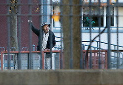The Scottish Independence camp (Indy Camp) has been evicted from the grounds of the Scottish Parliament.<br /> <br /> Pictured: Dean Halliday remains defiant with a clenched fist after leaving Indy Camp