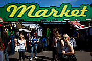 Busy summer day at Camden Market, North London. Camden Lock is a crowded hang out for young Londoners and tourists.