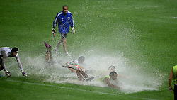 23.07.2011, Rajamangala National Stadium, Bangkok, THA, Chelsea FC Asia Tour, Training, im Bild // Chelsea's Didier Drogba dives on the pitch after torrential rain left it resembling a swimming pool during a training session at Rajamangala National Stadium in Bangkok on the club's preseason Asia Tour, EXPA Pictures © 2011, PhotoCredit: EXPA/ Propaganda/ D. Rawcliffe *** ATTENTION *** UK OUT!