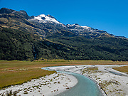 View Rees River from Rees-Dart Track in flats of Rees Valley Station, Otago region, South Island of New Zealand. In 5 days, we tramped the strenuous Rees-Dart Track for 39 miles plus 12.5 miles side trip to spectacular Cascade Saddle, in Mount Aspiring National Park.