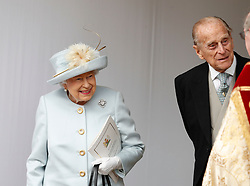 Queen Elizabeth II and the Duke of Edinburgh leave after the wedding of Princess Eugenie of York and Jack Brooksbank in St George's Chapel, Windsor Castle.