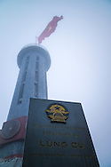 Flag tower of Cot co Lung Cu, located at the peak of Rong Mountain about 1,700m above sea level in Lung Cu Commune, Dong Van District, Ha Giang Province, Vietnam, Southeast Asia. The tower contains representations of Vietnam's 54 ethnic groups and symbolizes national pride and unity.