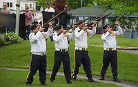 Members of VFW Post 33 perform a gun salute during Memorial Day services at Hesky Park in Meredith on Monday morning.  (Karen Bobotas/for the Laconia Daily Sun)